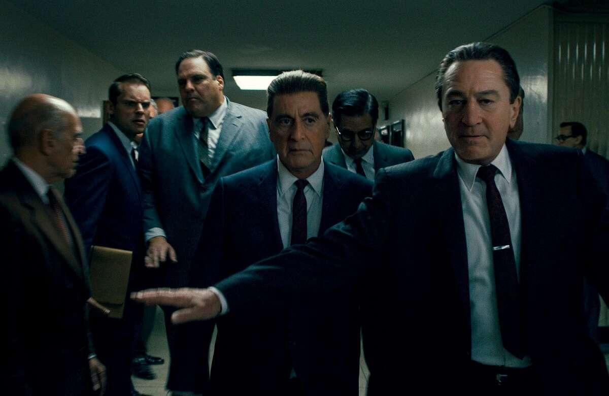 "Al Pacino (center) and Robert De Niro (right) in Martin Scorsese's new film, ""The Irishman."" MUST CREDIT: Netflix"