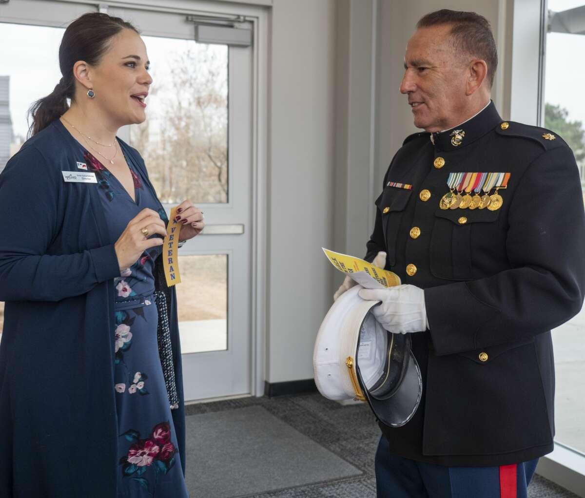 Anita Gamertsfelder hands out Veteran ribbons, but ret. Major Ramon Armendariz, USMC, declines to pin one on his dress uniform 11/11/19 at the annual MISD Veterans Day Show at Bowie Fine Arts Academy Tim Fischer/Reporter-Telegram