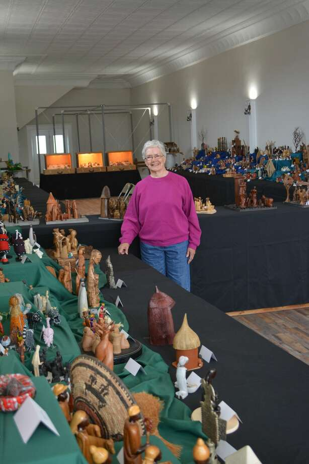 Carolyn Cunningham stands among her collection of nativities, which is currently on display at the Floyd County Historical Museum in Floydada. Photo: Ian Kirk/For The Herald