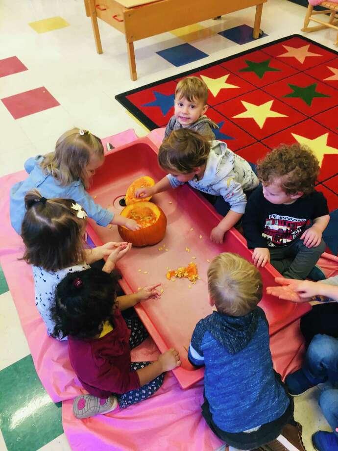 Toddlers at B'nai Torah Nursery School had fun exploring pumpkins. Photo: Contributed Photo