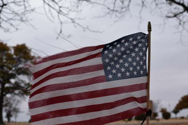Volunteers marked veterans' graves with flags on Friday at the Plainview cemeteries.