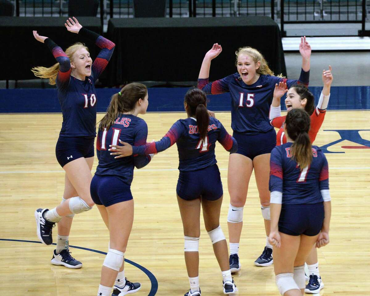 The Dulles Vikings celebrate a point during the third set of a Class 6A Region III bi-district volleyball playoff match against the Katy Tigers on Monday, November 4, 2019 at the Leonard Merrell Center, Katy, TX.