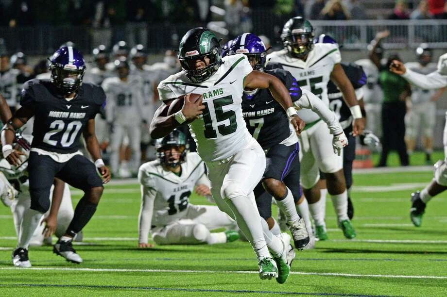 Mayde Creek's Julius Loughridge rushes as Morton Ranch's Samuel Hampton (7) and Matthew Apata (20) pursue during their District 19-6A football game Nov. 8 at Legacy Stadium. Photo: Craig Moseley, Houston Chronicle / Houston Chronicle / ©2019 Houston Chronicle