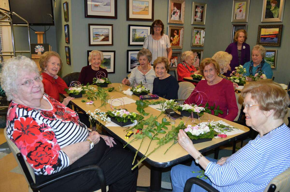 Residents at The Buckingham senior living community gather on Thursday, Nov. 7, to build floral arrangements for memory care residents. November is Alzheimer's Awareness Month, and 1.76 million Texans battle the debilitating disease.