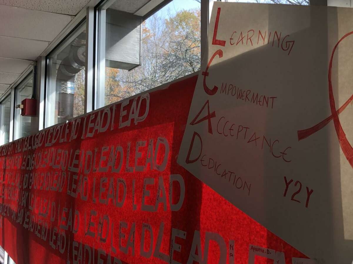 A red ribbon banner runs the length of a cafeteria wall at Middlebrook School, signifying Red Ribbon Week's theme of leadership.