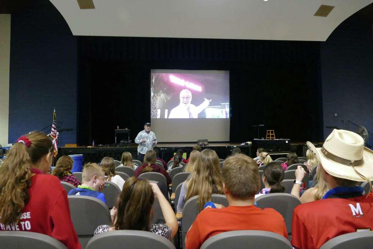 Comedian and motivational speaker Kevin Wanzer addresses students at Middleobrook School.