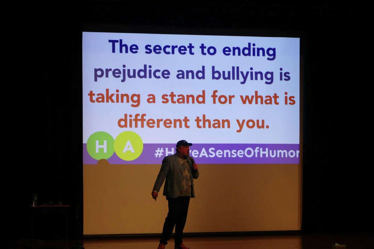 Comedian and motivational speaker Kevin Wanzer addresses students are Middleobrook School during Red Ribbon Week in November 2019.