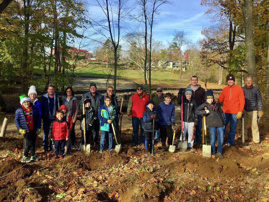 Cub Scout Pack 70 recently planted 800 daffodil bulbs on the hillside behind Anderson Pond leading to Jeniam Meadow in Waveny Park. Pack 70 Cubmaster Stephen Prostor organized the Scouts and parents working together with Waveny Park Conservancy President Caroline Garrity and Board Member Chris Schipper. The blooms should be a visual treat when viewed from Waveny House next spring. Photo: Contributed Photo