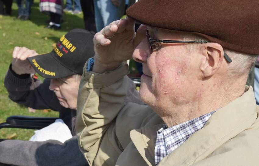 Spectrum/The annual Veterans Day ceremony was held on the south end of the Village Green in New Milford Nov. 11, 2019. Above, veterans Michael Cherney, right, and Ed Tierney, both of Candlewood Valley Health & Rehabilitation, offer a salute during the National Anthem.