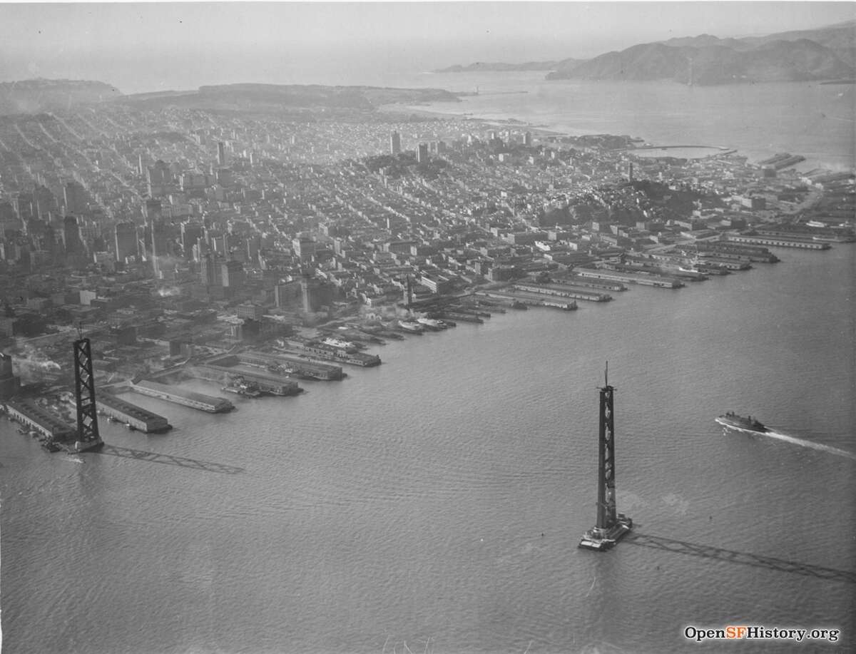 The Bay Bridge towers under construction in Oct. 1934. The Golden Gate Bridge can also be seen under construction.