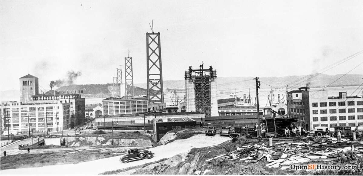 The Bay Bridge towers under construction in 1935. Hills Brothers can been seen at left.