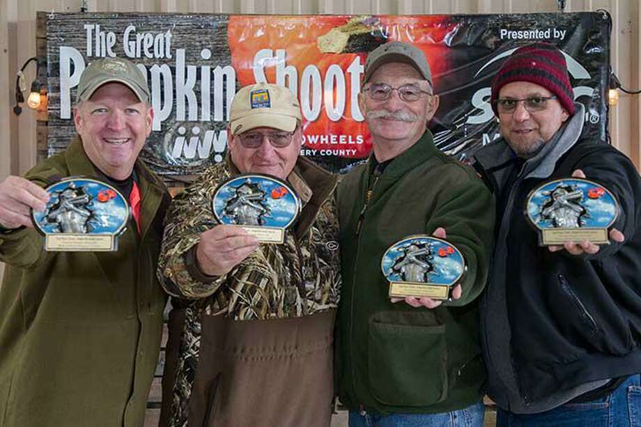 The Great Pumpkin Shoot on Oct. 25 raised $82,000 for Meals on Wheels. Pictured is second place team, Will Simpler, Judge Mark Keough, JT Dibble and Guto Felipe. Photo: Courtesy Photo