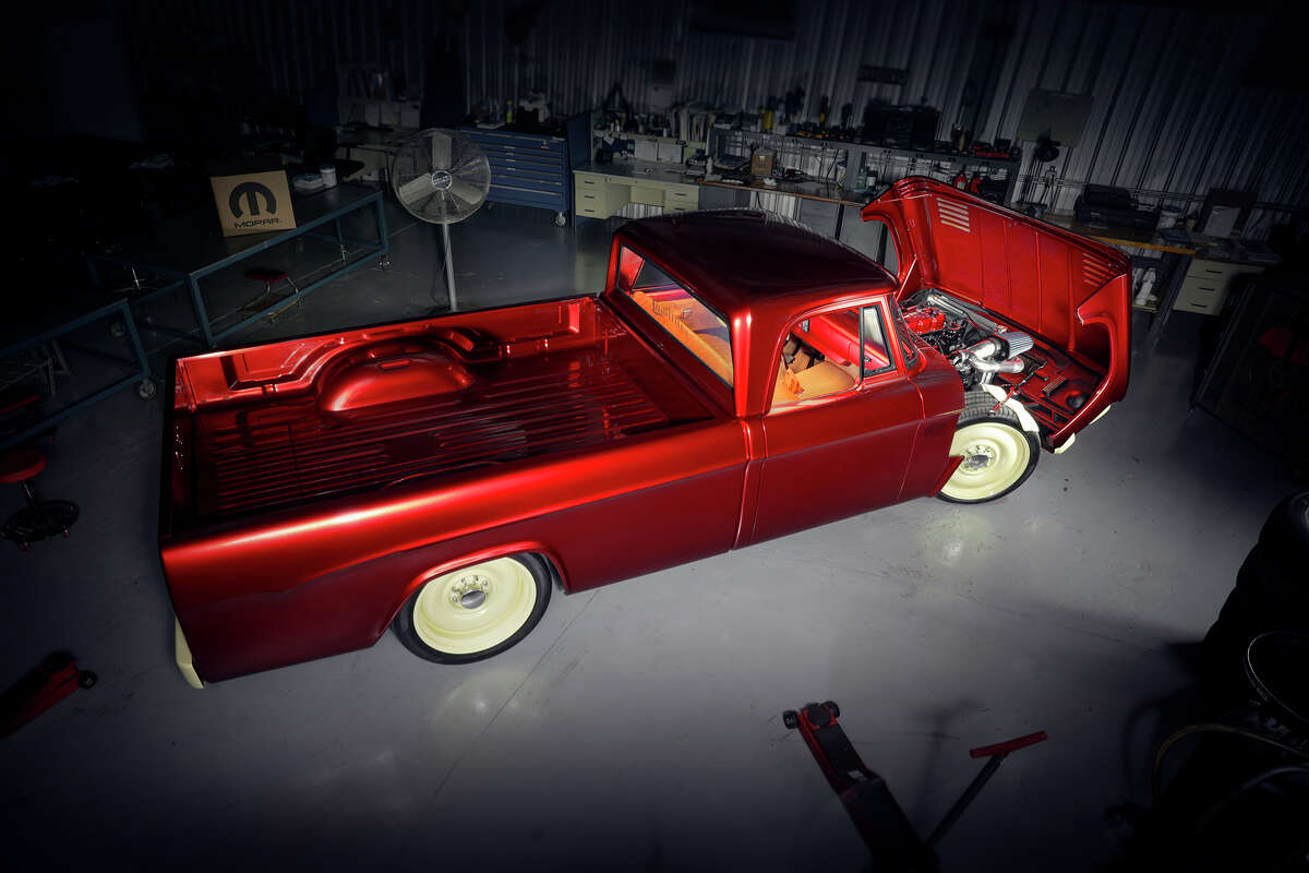 Mopar designers redesigned a 1968 Dodge D200-series heavy-duty pickup truck to transform it into the Candied Delmonico Red and Dairy Cream Mopar Lowliner Concept. (FCA US LLC/TNS)