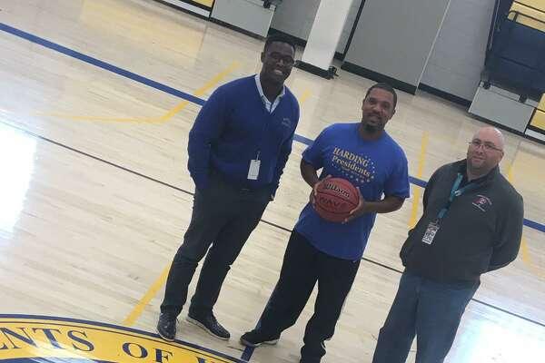 Harding Principal Dane Brown, LaMar Kennedy andHarding Athletic Director Andrew Grasso