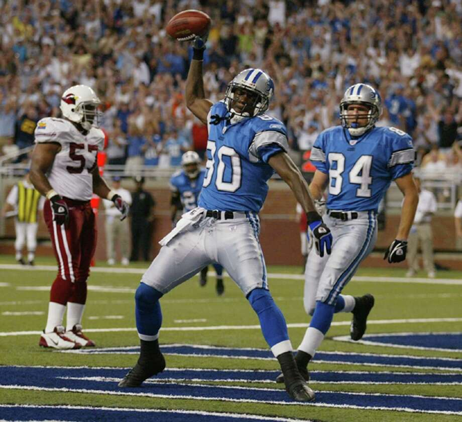 Detroit Lions wide receiver Charles Rogers (80) celebrates his second touchdown of the game in front of teammate Bill Schroeder (84) and Arizona Cardinals' Ronald McKinnon (57) during second quarter action on Sunday, Sept. 7, 2003 at Ford Field in Detroit, Mich. Rogers died late Sunday, Nov. 10, 2019 at just 38. Photo: JULIAN H. GONZALEZ, TNS / Detroit Free Press