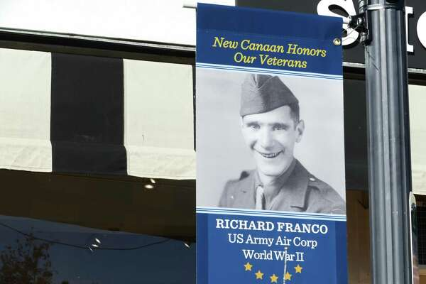 Jack Goetz had banners made and hung lampposts on Elm Street in New Canaan to honor local veterans for his Eagle Scout project.They were hung November 2019.