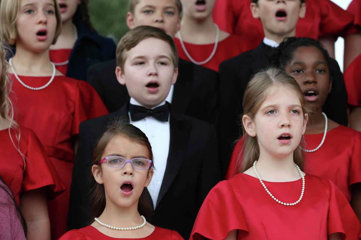 The Texas Children's Choir performs during the Veterans Day ceremony at Fort Sam Houston National Cemetery on Monday to honor military veterans and families. The choir has 60 boys and girls between the ages of 8 to 18.