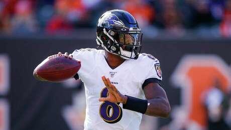 Baltimore Ravens quarterback Lamar Jackson looks to pass during the first half of NFL football game against the Cincinnati Bengals, Sunday, Nov. 10, 2019, in Cincinnati. (AP Photo/Gary Landers)