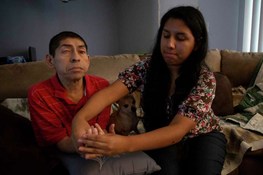 In Houston, Lorena Argueta, 26, helps her father after checking his blood sugar. It's National Family Caregivers Month — a time to recognize and appreciate those who care for loved ones without pay. Photo: Godofredo A Vásquez / Staff Photographer / © 2019 Houston Chronicle
