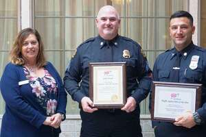 AAA Branford Branch Manager Tina Cacopardo, left, presented Sgt. Patrick Smyth and Officer Matt Swift with their respective awards.
