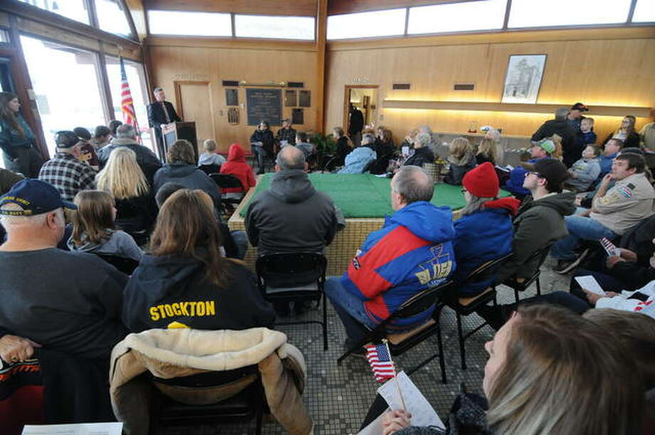 People pack inside the East Alton Village Hall for Monday's Veterans Day ceremony after snow and wind prevented this year's event from being held at the park.