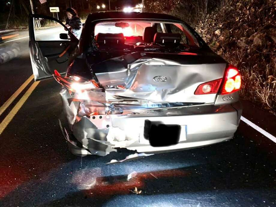 The damaged Infiniti G35 following Friday night's crash on Ball Pond Road in New Fairfield. Photo: Contributed Photo
