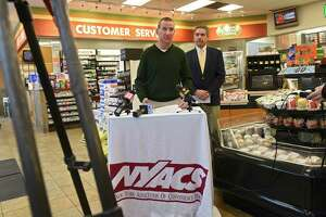 Christian King, Campus Mobil convenience store owner, speaks during a press conference at Campus Mobil regarding Albany County tobacco flavor ban legislation on Monday, Nov. 11, 2019 in Albany, N.Y. Jim Calvin, president, New York Association of Convenience Stores, stands at right. (Lori Van Buren/Times Union)