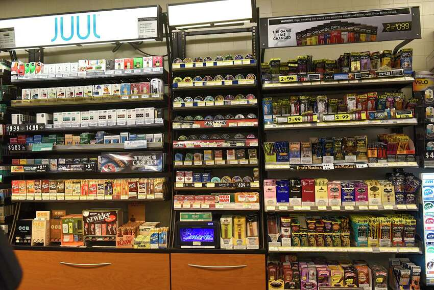 Different flavored tobacco products are seen behind the register area during a press conference at Campus Mobil regarding Albany County tobacco flavor ban legislation on Monday, Nov. 11, 2019 in Albany, N.Y. (Lori Van Buren/Times Union)