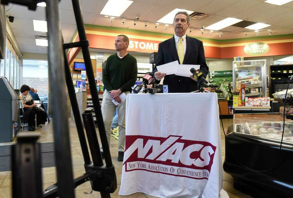 Jim Calvin, president, New York Association of Convenience Stores, speaks during a press conference at Campus Mobil regarding Albany County tobacco flavor ban legislation on Monday, Nov. 11, 2019 in Albany, N.Y. Christian King, Campus Mobil convenience store owner, stands at left. (Lori Van Buren/Times Union)
