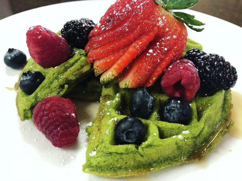 A gluten-free kale and matcha tea waffle with fresh fruit from Marla Restaurant Photo: Marla Restaurant