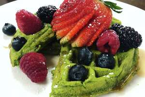 A gluten-free kale and matcha tea waffle with fresh fruit from Marla Restaurant