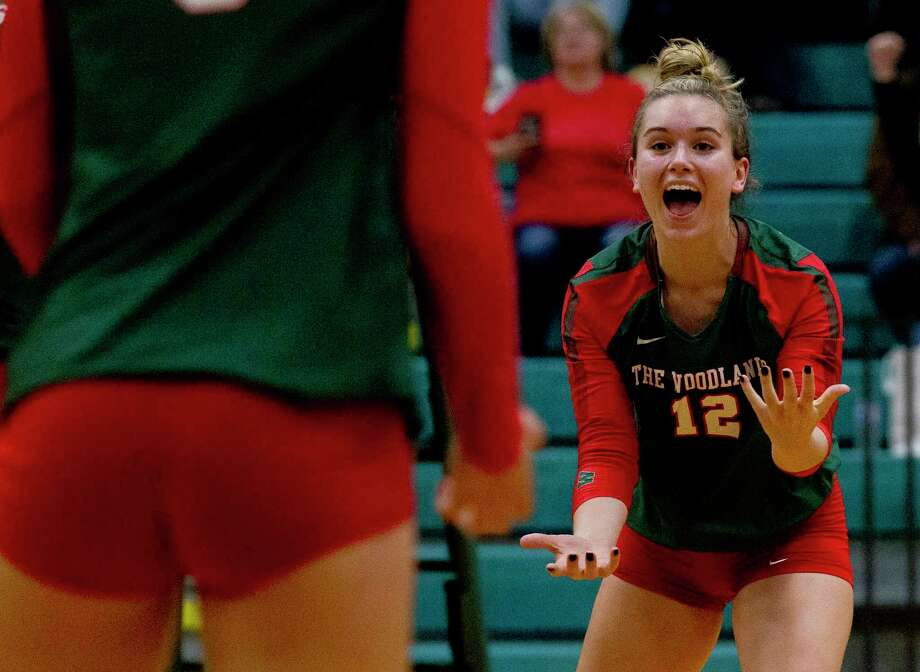 The Woodlands setter Clara Brower (12) reacts after a point by outside hitter Dylan Maberry during the first set of a Region II-6A area high school volleyball playoff match at Brenham High School, Thursday, Nov. 7, 2019, in Brenham. Photo: Jason Fochtman, Staff Photographer / Houston Chronicle