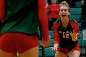 The Woodlands setter Clara Brower (12) reacts after a point by outside hitter Dylan Maberry during the first set of a Region II-6A area high school volleyball playoff match at Brenham High School, Thursday, Nov. 7, 2019, in Brenham.