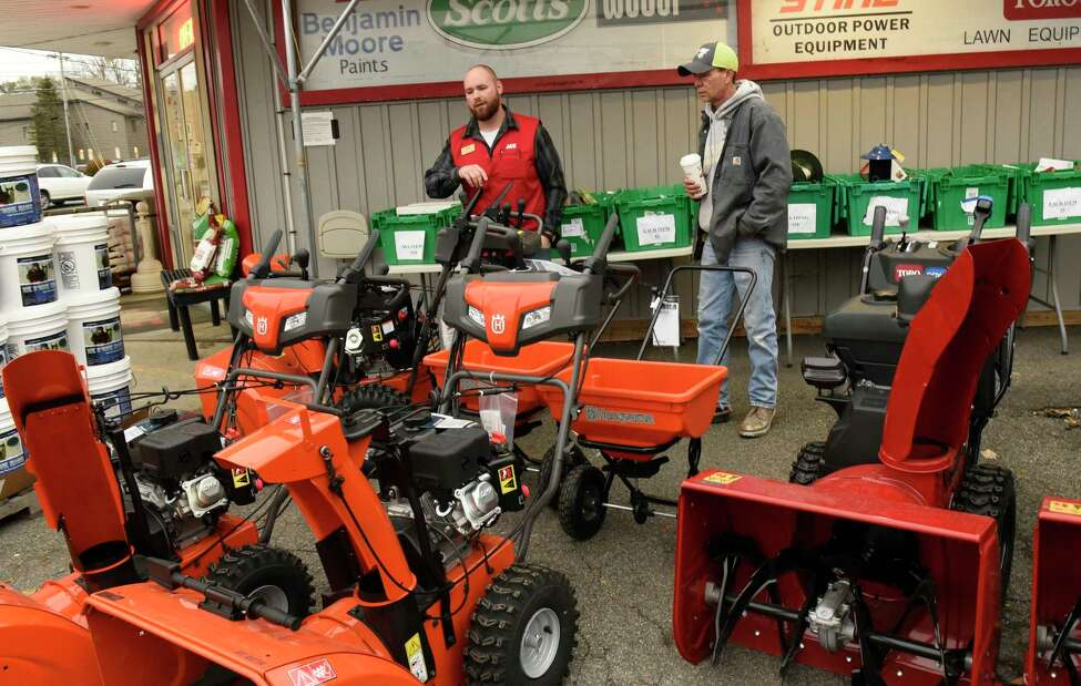 Gordon James of Gansevoort, right, looks at snowblowers with help from store manager Rob McDonnell at Robinson Ace Hardware store on Monday, Nov. 11, 2019 in Guilderland, N.Y. Snow is expected in the area tonight into tomorrow. (Lori Van Buren/Times Union)