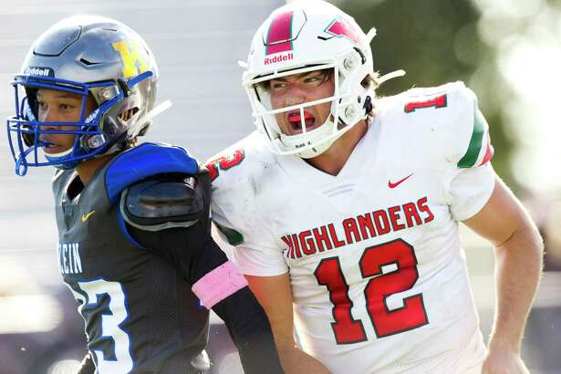 The Woodlands quarterback Ben Mills (12), shown here last month against Klein, totaled four touchdowns Friday night against Klein Forest and was voted The Courier's Player of the Week.