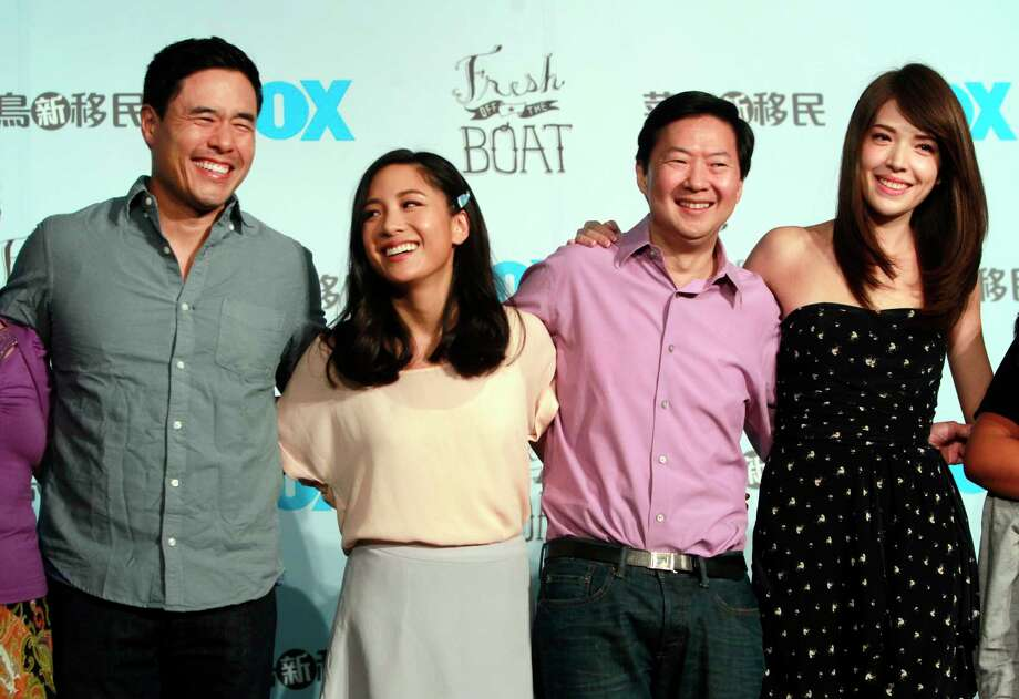 """FILE - In this Aug. 5, 2016 file photo, Randall Park, from left, Constance Wu, Ken Jeong and Ann Hsu pose for photographers during a media event announcing their comedy series """"Fresh off the Boat"""" in Taipei, Taiwan. ABCa€™s a€œFresh Off the Boata€ is coming to an end after six seasons. The network said Friday, Nov. 8, 2019,  the comedy about an Asian American family in the 1990s will wrap with an hour-long finale.  The last episode will air Feb. 21. (AP Photo/Chiang Ying-ying, File Photo: Chiang Ying-ying / Copyright 2016 The Associated Press. All rights reserved. This m"""