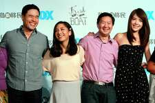 """FILE - In this Aug. 5, 2016 file photo, Randall Park, from left, Constance Wu, Ken Jeong and Ann Hsu pose for photographers during a media event announcing their comedy series """"Fresh off the Boat"""" in Taipei, Taiwan. ABCa€™s a€œFresh Off the Boata€ is coming to an end after six seasons. The network said Friday, Nov. 8, 2019, the comedy about an Asian American family in the 1990s will wrap with an hour-long finale. The last episode will air Feb. 21. (AP Photo/Chiang Ying-ying, File"""