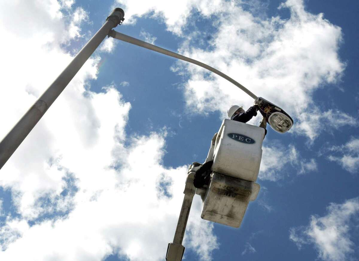 A streetlight fixture being repaired in New Haven.
