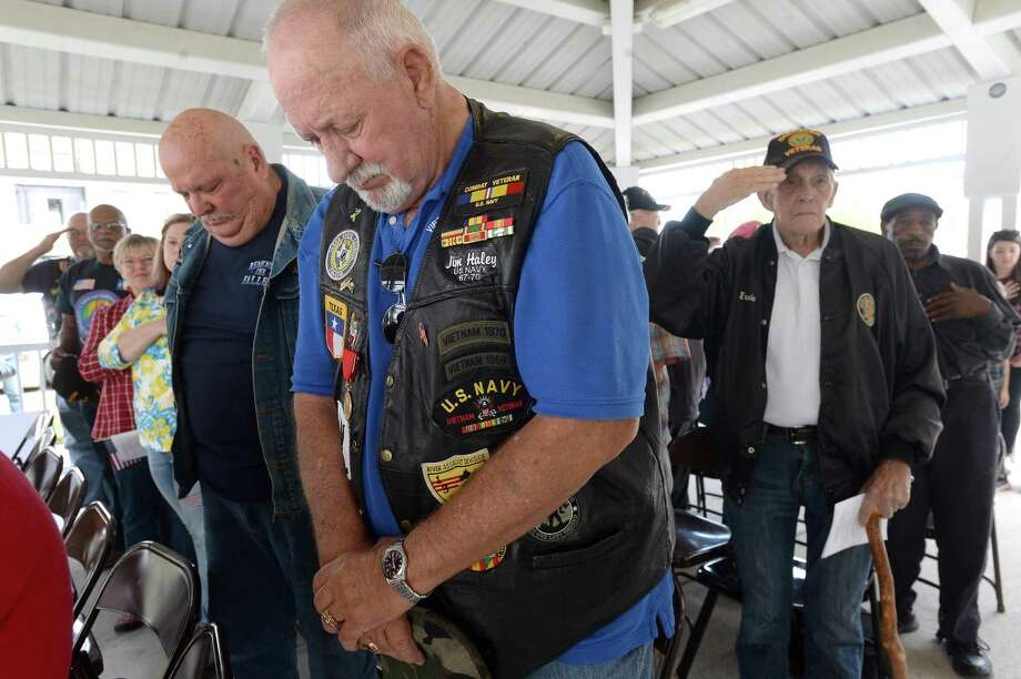 "Veterans, including (from left) Chester Lafley, Jim Haley and Ernie Lewery, observe the playing of ""Taps"" during the annual Veterans Day Service held Monday at the Beaumont Fire Museum. Veterans, local officials and other members of the community gathered to honor those who have served. A reception in the museum followed the program under the pavilion.  Photo taken Monday, November 11, 2019 Kim Brent/The Enterprise Photo: Kim Brent / The Enterprise / BEN"