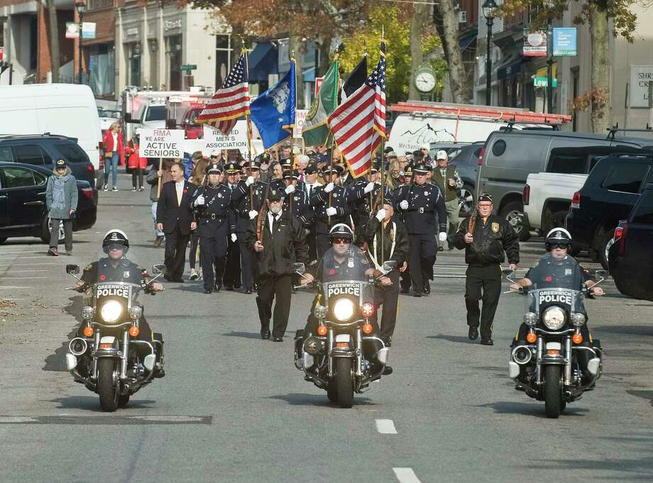 A parade of veterans march down Greenwich Avenue for the Veterans Day ceremony. Monday, Nov. 11, 2019 Photo: Scott Mullin / For Hearst Connecticut Media / The News-Times Freelance