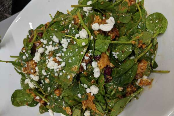 Smoky Apple Cider, Squash and Spinach Salad is a diabetes-friendly dish provided by the Nourish Program at the UTHealth School of Public Health.