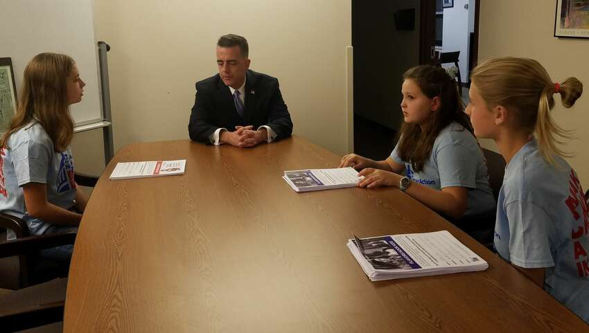 Three eighth-grade students from Bethlehem Central Middle School met with the chairman of the Albany County Legislature, Andrew Joyce, on Wednesday, Nov. 6, 2019. They presented him with 220 petitions in support of Local Law E, which would restrict the sale of flavored tobacco products in Albany County.