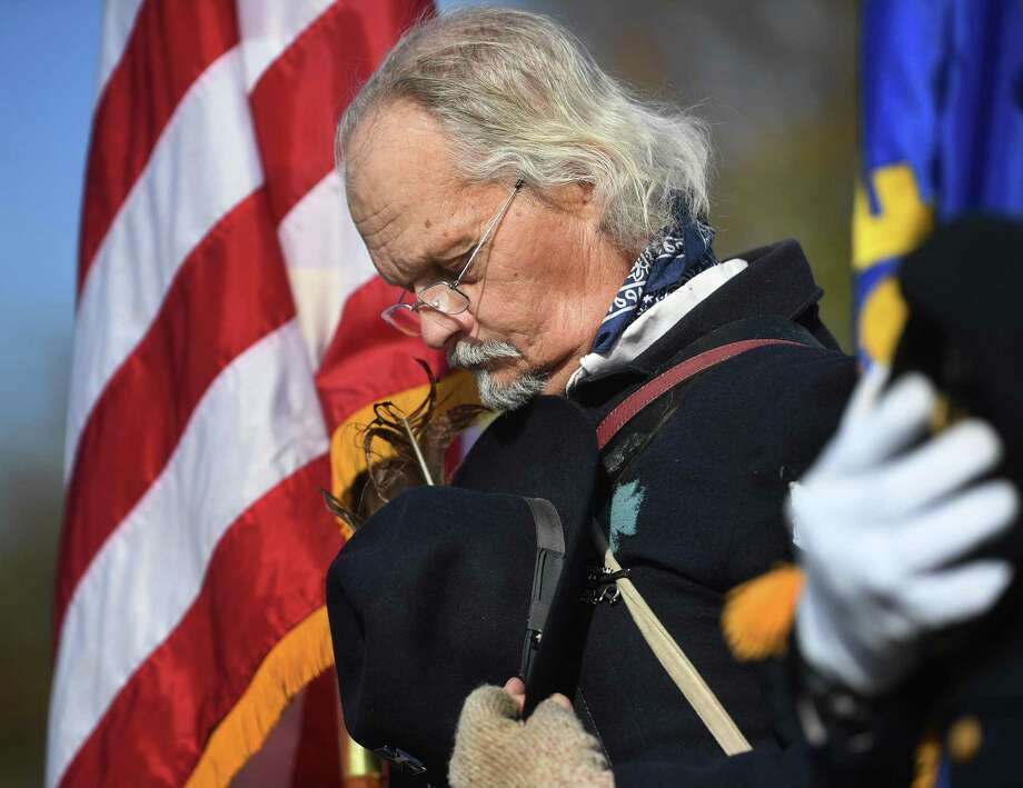 Martin Spring, of Waterbury, a member of the Ansonia/Derby chapter of the Sons of Union Veterans of the Civil War, bows his head during the annual Veterans Day ceremony at Veterans Memorial Park in Shelton, Conn. on Monday, November 11, 2019. Photo: Brian A. Pounds / Hearst Connecticut Media / Connecticut Post