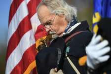 Martin Spring, of Waterbury, a member of the Ansonia/Derby chapter of the Sons of Union Veterans of the Civil War, bows his head during the annual Veterans Day ceremony at Veterans Memorial Park in Shelton, Conn. on Monday, November 11, 2019.