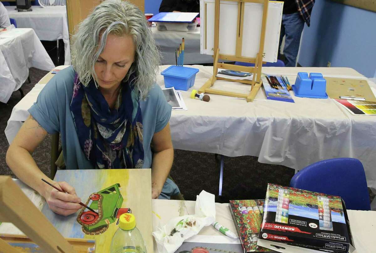 Sara McEathron works on a painting during a veterans' art class. The classes - offered by Bihl Haus' Forward, Arts! program in partnership with Vet TRIIP - are taught in a portable classroom at St. Andrew Presbyterian Church.