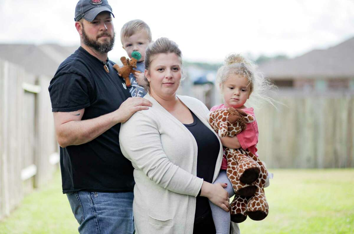 Melissa and Dillon Bright with their children, Charlotte and Mason, outside their home in Tomball. (Elizabeth Conley/Houston Chronicle)