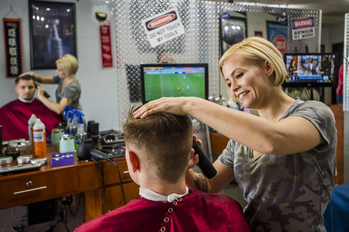 MMA fighter and barber Kaelen Doan finishes up a haircut for Austin Sparks during her shift at The Man Cave barber shop Thursday, Nov. 7, 2019 in Midland. (Katy Kildee/kkildee@mdn.net)