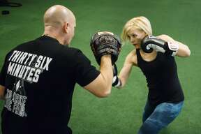 MMA fighter Kaelen Doan trains with her boxing coach, Erik Evers, at Edge Fitness and Training Headquarters Thursday, Nov. 7, 2019 in Midland. (Katy Kildee/kkildee@mdn.net)