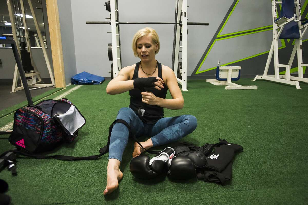 Kaelen Doan wraps her wrists and hands before training at Edge Fitness and Training Headquarters Thursday, Nov. 7, 2019 in Midland. (Katy Kildee/kkildee@mdn.net)