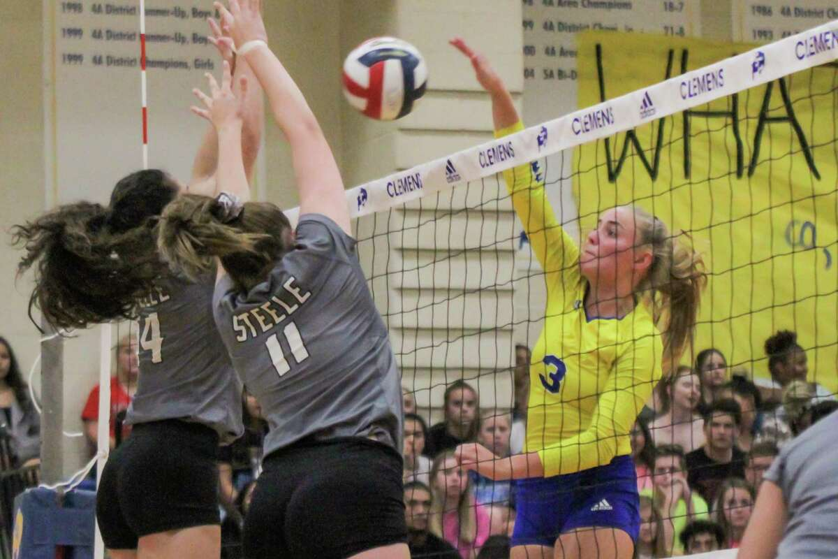 Steele Knights Malia Viernes (14) and Hailey Burgess (11) try to block Ashley Breu's shot during the Clemens Buffaloes' 25-22, 25-19, 25-20 sweep Sept. 17 at Clemens High School.
